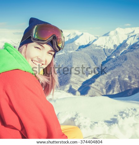 Snowboard. Female snowboarder or skier on the background of Alps, Swiss summit. Mountain. Blue sky - stock photo