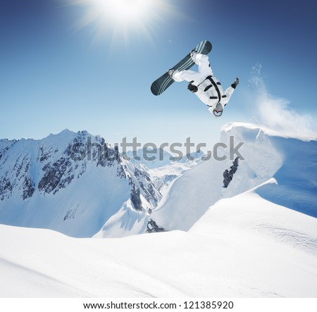 Snowboard Jumping in high mountains - stock photo