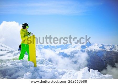 snowboarder against sun and mountains - stock photo