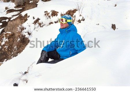 Snowboarder examines the slopes - stock photo