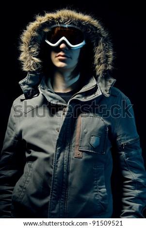 Snowboarder fashion portrait on black - stock photo