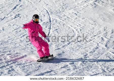 Snowboarder girl in the pink in the Alps