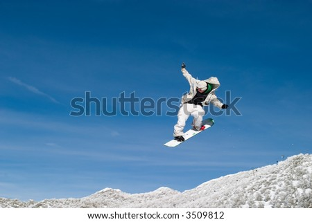 Snowboarder High in the air with open arms