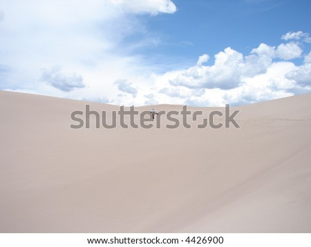 Snowboarder hiking up the Great Sand Dunes