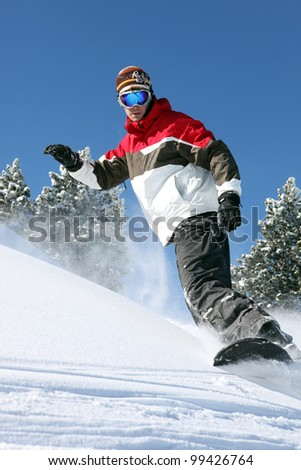 Snowboarder in action - stock photo