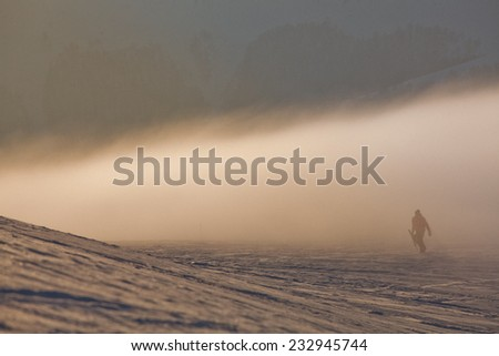 Snowboarder in high mountains - stock photo