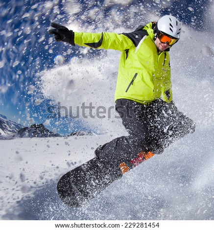 Snowboarder in high mountains during sunny day. - stock photo