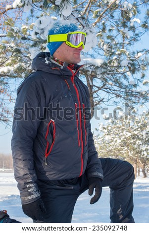 Snowboarder in the winter forest - stock photo