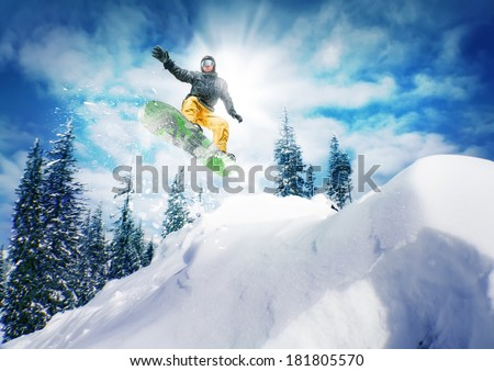 Snowboarder  jump - stock photo