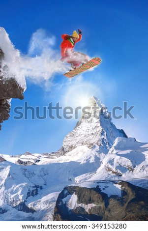 Snowboarder jumping against Matterhorn peak in Switzerland