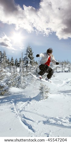 snowboarder jumping against sunset - stock photo