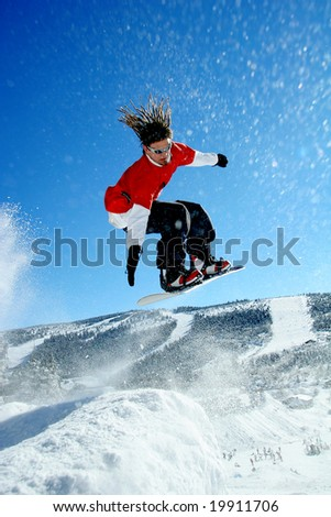 snowboarder jumping to the air - stock photo