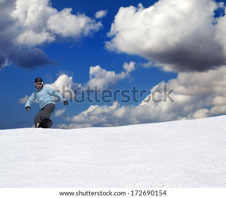 Snowboarder on off-piste slope at nice sun day - stock photo