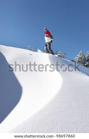 Snowboarder on piste - stock photo