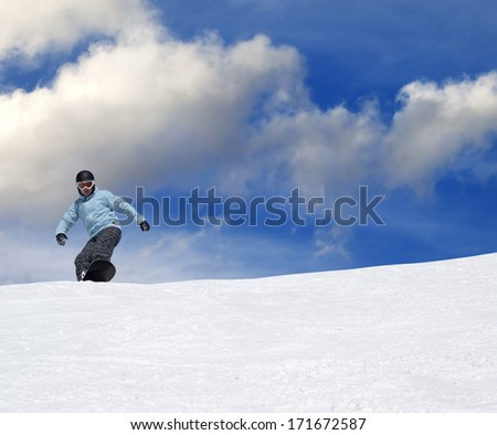 Snowboarder on ski slope at nice day
