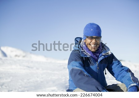 Snowboarder Resting on Hill - stock photo