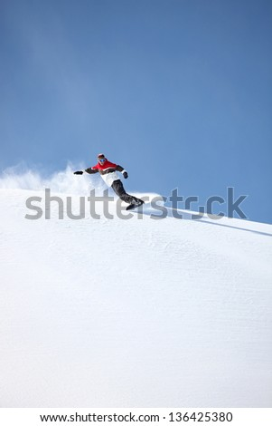 Snowboarder showing-off his skills - stock photo
