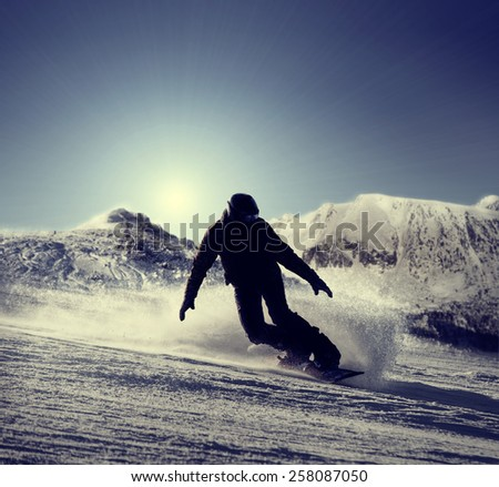 Snowboarder silhouette  - stock photo
