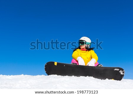snowboarder sitting on snow mountain slope copy space blue sky