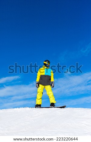 Snowboarder sliding down the hill, snow mountains snowboarding on slopes