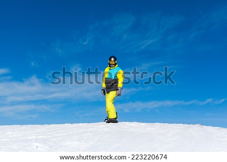 Snowboarder sliding down the hill, snow mountains snowboarding on slopes - stock photo