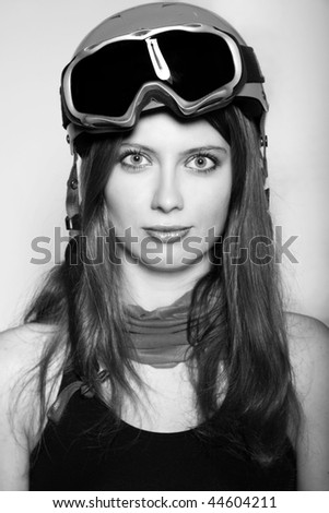 Snowboarder woman wearing a helmet and mask - stock photo