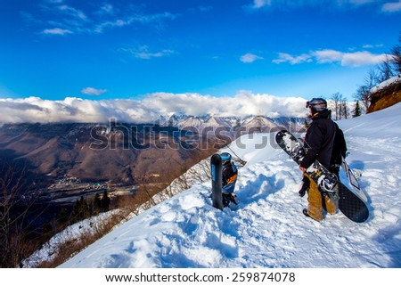 Snowboarders - stock photo