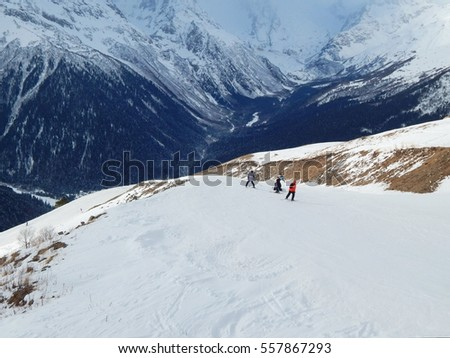 Snowboarders and skiers at the altitude 2 000 metres in Dombay in Russia. The shot was made in December 2016