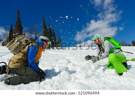 Snowboarders Couple enjoy the ski resort