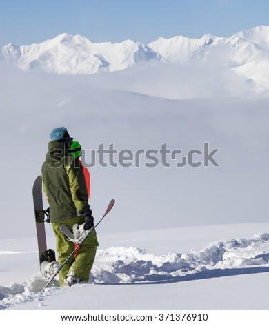 Snowboarders on off-piste slope after snowfall. Caucasus Mountains, Georgia, region Gudauri. - stock photo