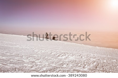 Snowboarders on snowy mountain - stock photo