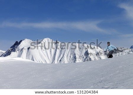 Snowboarding in high mountains - stock photo
