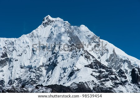 Snowbound mountain peaks in Himalayas. Alpinism and hiking