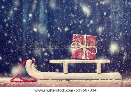 Snowbound Santa's sled with red gift box