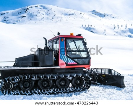 snowcat at work in a snowy valley