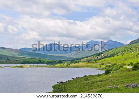 Snowdon, the highest of the Welsh mountains, from a viewpoint beside the Llynnau Mymbyr lakes in the peaceful green valley of Dyffryn Mymbyr, near Capel Curig, Conwy, north Wales. - stock photo
