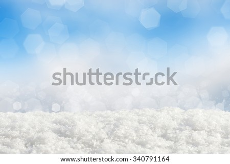 Snowdrift on abstract blue bokeh background - stock photo