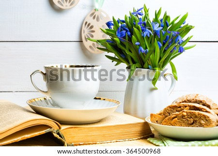 snowdrops in a vase on a table on a white background, Easter  - stock photo