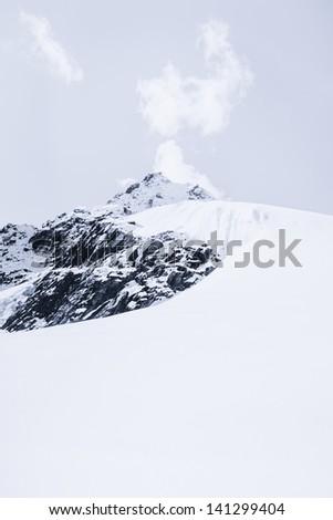 Snowed mountain summit and rocks in Himalaya. Travel to Nepal - stock photo