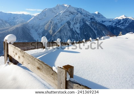 snowed wooden fence - stock photo
