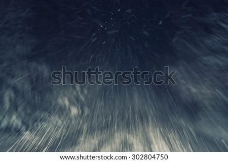 snowfall on a country road at night, natural photography - stock photo