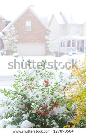 Snowfall on a street in an american town, view from front porch. shallow dof - stock photo