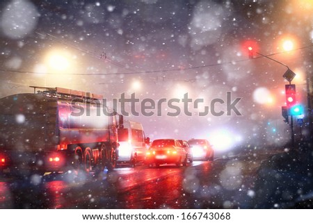 snowfall road at night in the city - stock photo
