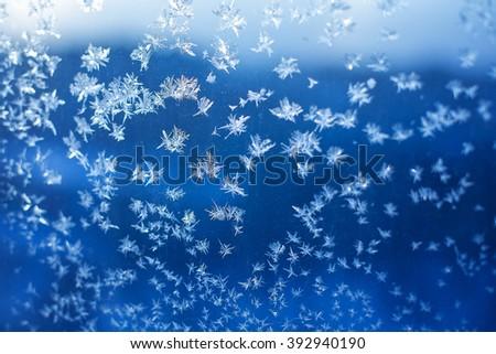 snowflackes on the window - stock photo