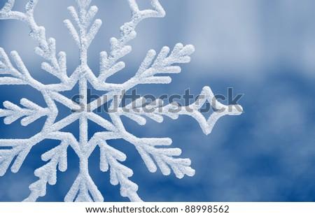 Snowflake big closeup. Bokeh a background. Toning is blue - stock photo