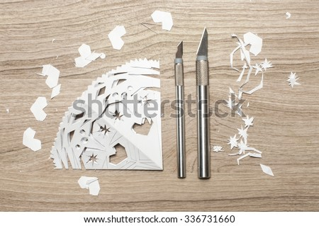 Snowflake carved with knife, out of paper. - stock photo