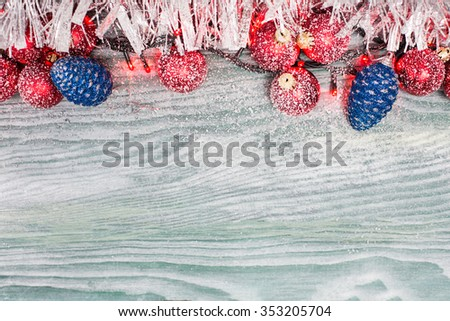 Snowflake Christmas Ornaments with fir greens against Rustic White Board Background with empty Room or space for copy, text, words. Horizontal - stock photo