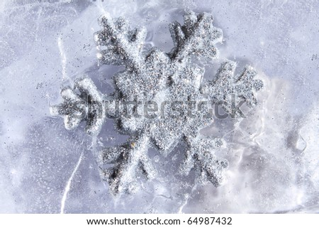 Snowflake frozen into the ice cold or winter season concept christmas time