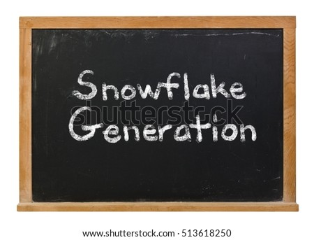 Snowflake generation written in white chalk on a black chalkboard isolated on white