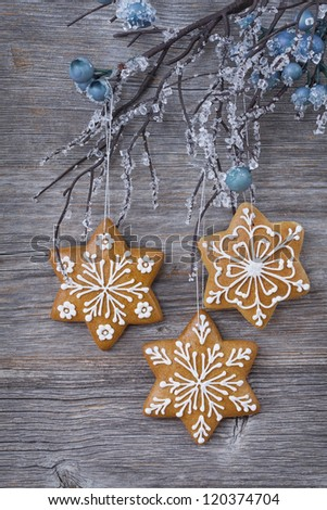 Snowflake gingerbread cookies on wooden background - stock photo